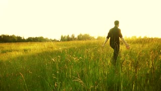 man-walking-in-the-field-with-the-tall-grass_4andrn__e__S0000